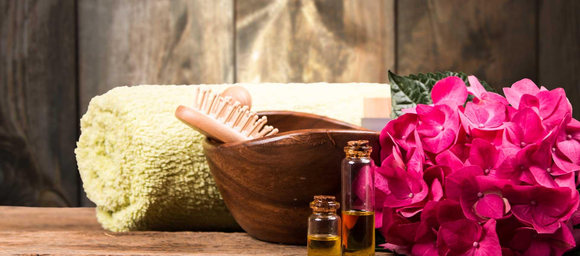 Spa and massage setting on wood